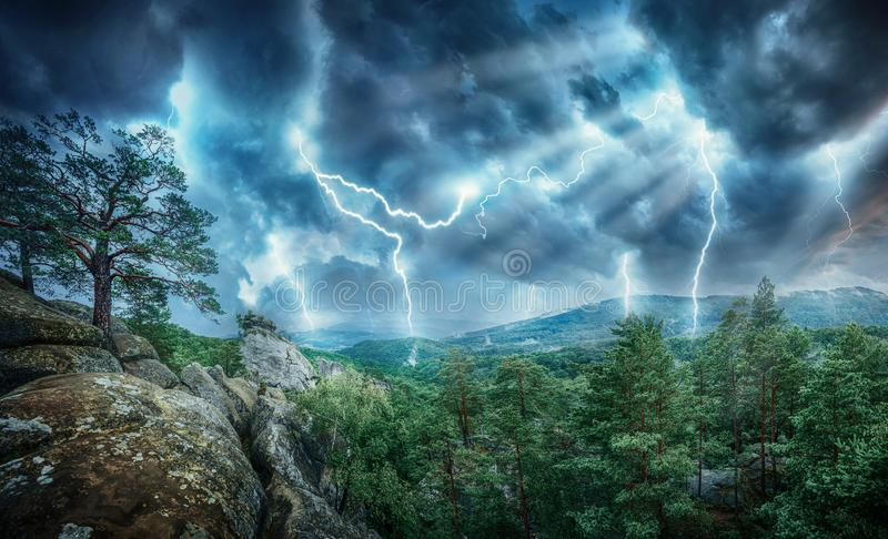 Lightning thunderstorm flash and sun lights in the mountains. Concept on topic weather, cataclysms hurricane, Typhoon, tornado, royalty free stock images