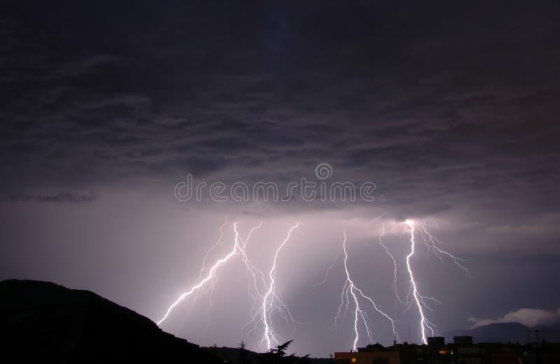 Lightnings. In a dark thunderous night stock photography