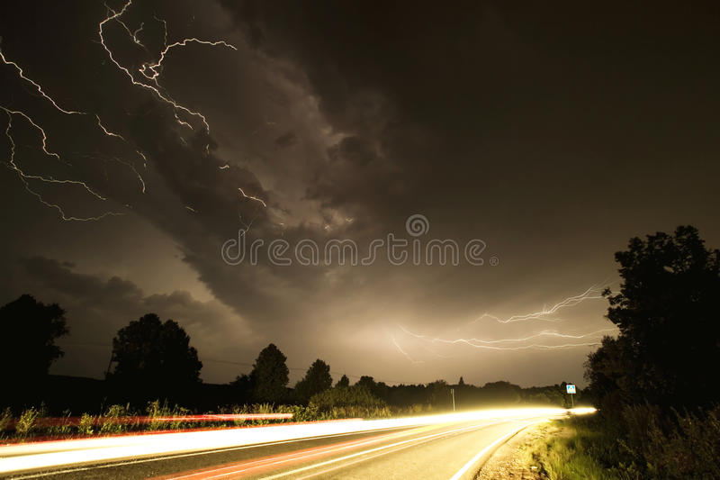 Lightnings over the road royalty free stock photography