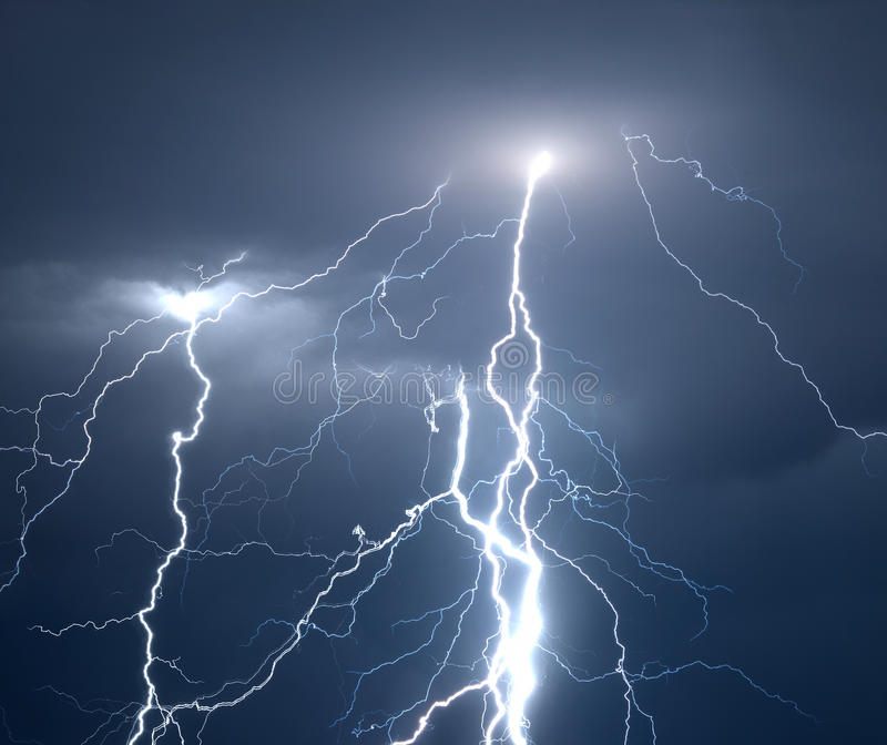 Lightnings and thunder during heavy summer storm stock images