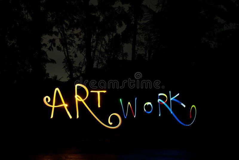 Lightpainting que escribe el trabajo de arte de la palabra en oscuridad fotografía de archivo libre de regalías