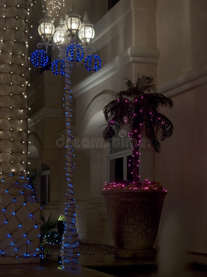 Lightpost And Palm Christmas Decorated Stock Photos