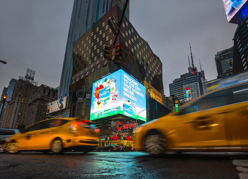 Lights of advertising on streets of Manhattan at evening time. NEW YORK, USA - Apr 30, 2016: Crossroad of 8th Ave and 42nd st. Lights and shadows of NYC. Lights stock image