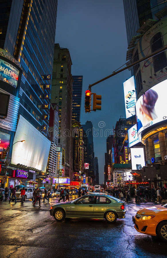 Lights of advertising on streets of Manhattan. NEW YORK, USA - Apr 30, 2016: W 42nd St on a rainy evening time. Lights and shadows of NYC. Lights of advertising stock photo