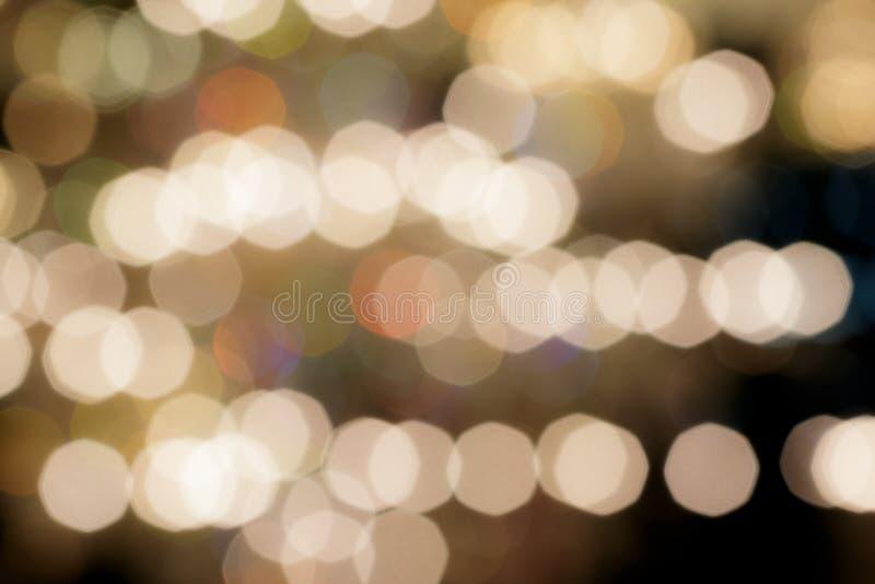 Lights blurred bokeh background from chrystal chandelier. Light stock photo