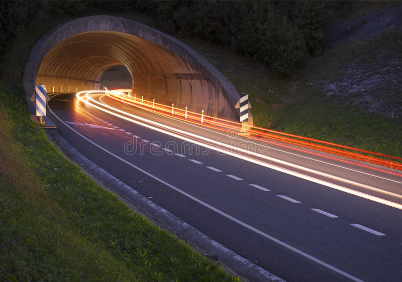 Lights of the cars on the road to the tunnel. royalty free stock photo