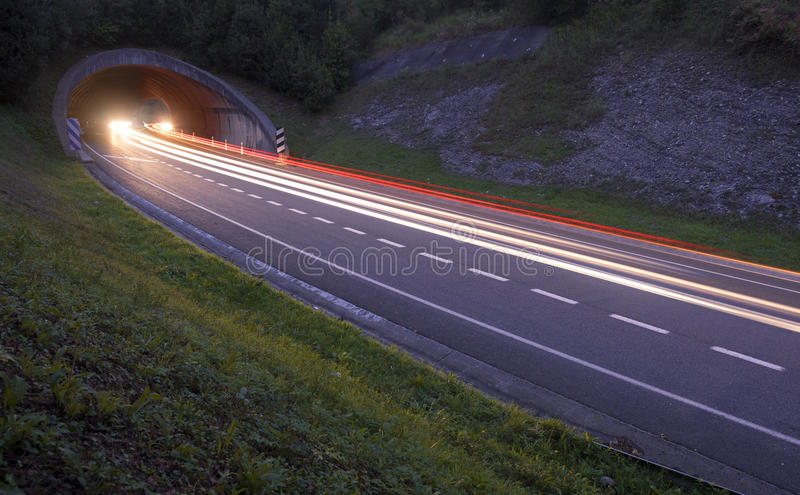 Lights of the cars on the road to the tunnel. stock photo