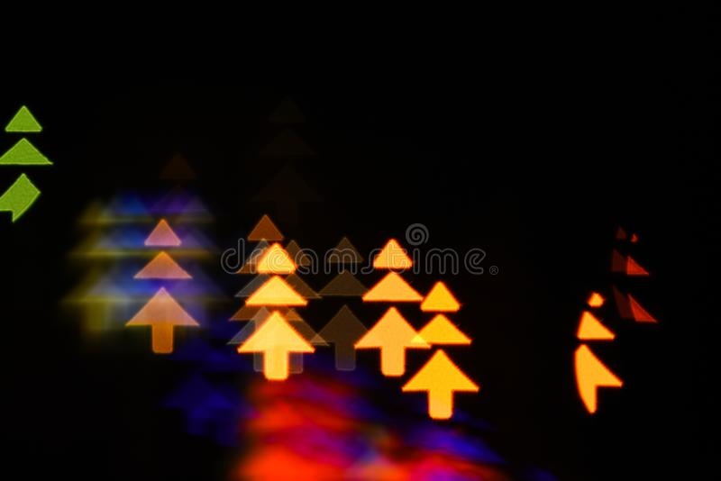 Lights of christmas garland blurred on black background. Lights of colorful garland blurred as beautiful background royalty free stock photo