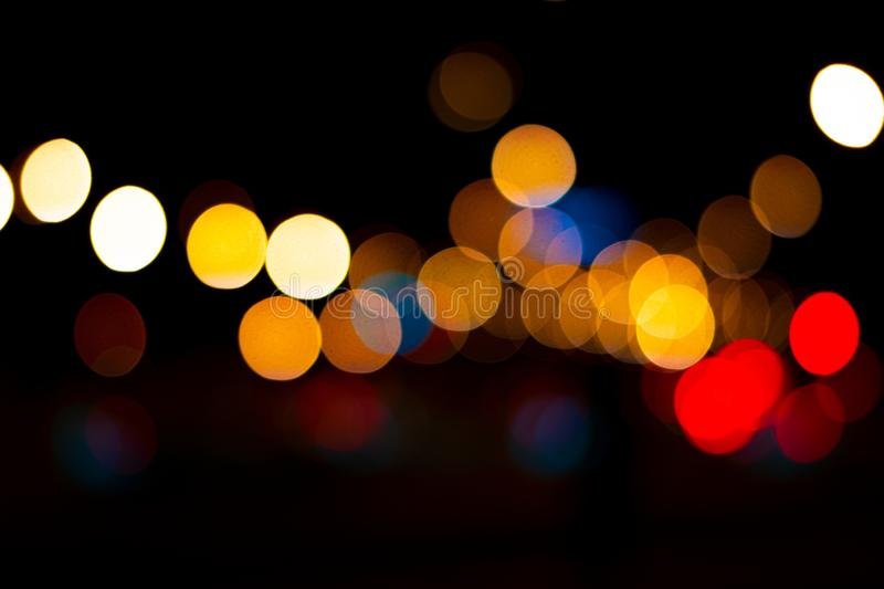 Lights in the city with lights blurred background for graphic design. Abstract, black, blue, blurry, bokeh, bright, brightly, cars, christmas, circle, circles royalty free stock photos