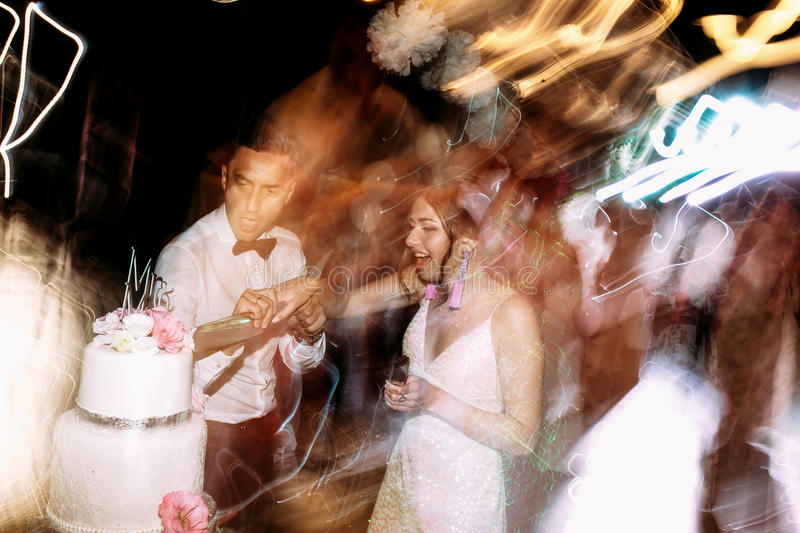 Lights of the dance floor and just married couple royalty free stock photos