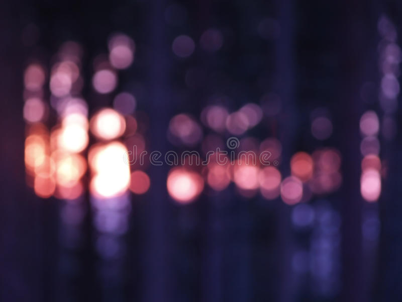 Lights in darkness. Abstract sunset in forest stock photography