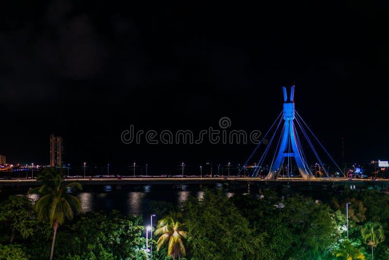Lights of Encanta Moca, Enchanted lady Bridge and Capibaribe river night view from Shopping Rio Mar, Recife, Pernambuco, Brazil. Lights of Encanta Moca stock image