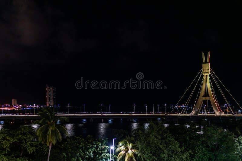 Lights of Encanta Moca, Enchanted lady Bridge and Capibaribe river night view from Shopping Rio Mar, Recife, Pernambuco, Brazil. Lights of Encanta Moca royalty free stock photos