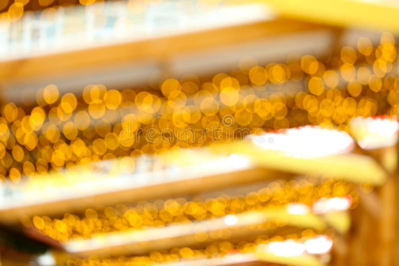 Lights of garlands at Christmas fair,. Blurred background stock photography