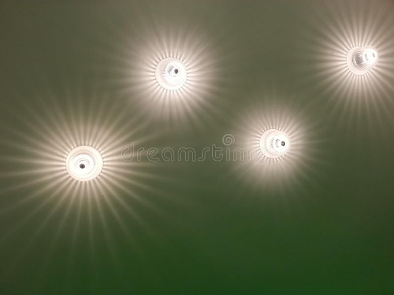 Lights on green ceiling stock images