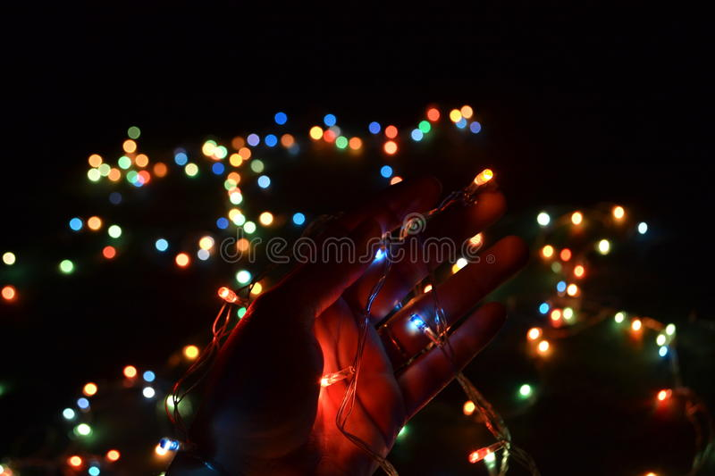 Lights in hand with bokeh background stock photography