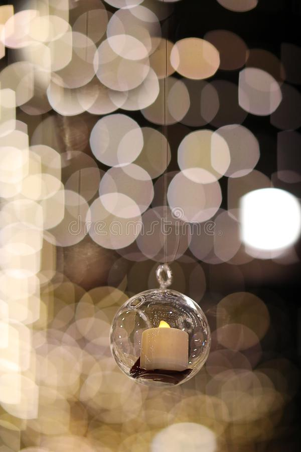 Lights and lanterns in the wedding. Bokeh. Candle light closeup with Bokeh background. Happy New years and Christmas celebration. Concept. Candles hanging from stock photo