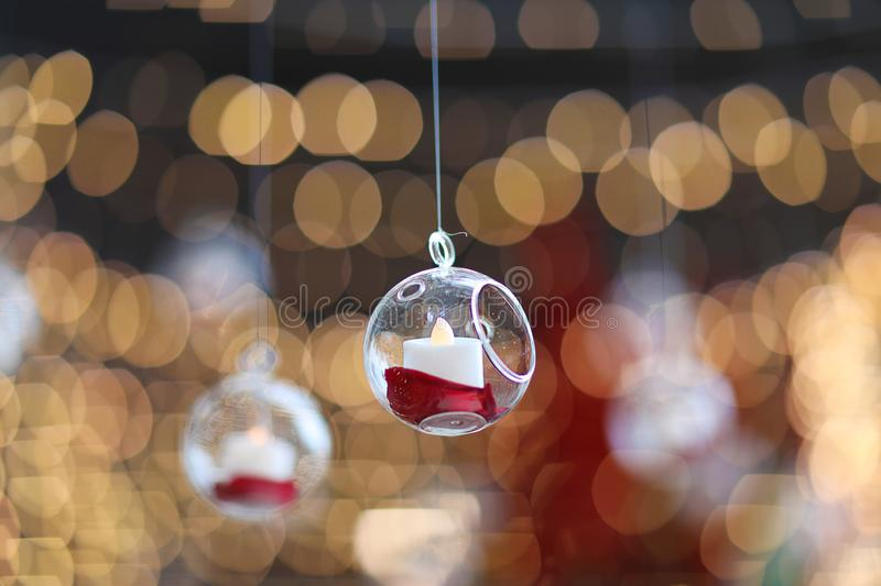 Lights and lanterns in the wedding. Bokeh. Candle light closeup with Bokeh background. Happy New years and Christmas celebration. Concept. Candles hanging from stock image