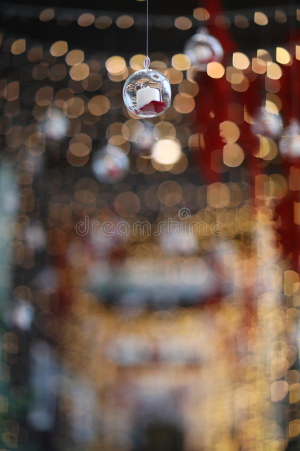 Lights and lanterns in the wedding. Bokeh. Candle light closeup with Bokeh background. Happy New years and Christmas celebration. Concept. Candles hanging from royalty free stock image
