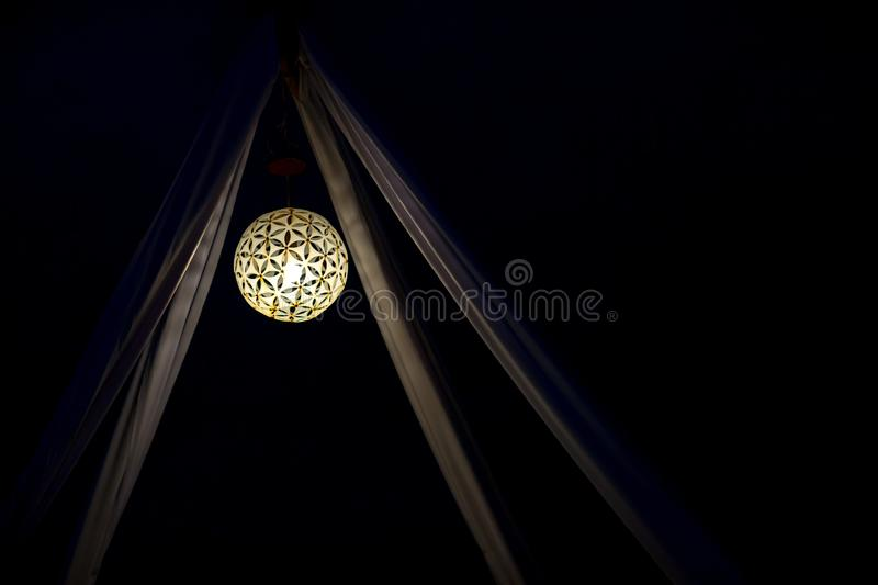 Lights and lanterns in the wedding. A decorative hanging lantern or a Lamp of Glass. stock photography