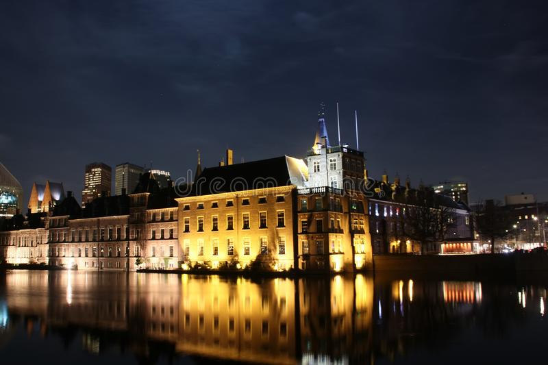 Lights on the parliament building named Binnenhof at the Hofvijver in the city center of the Hague in the Netherlands royalty free stock photo