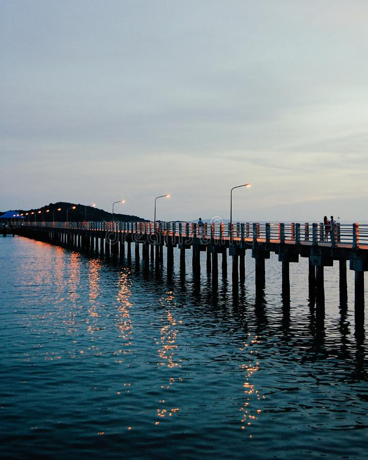 Lights of the pier reflecting in ocean water stock photos