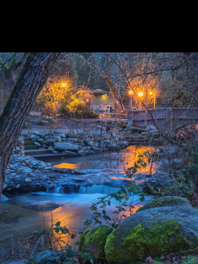Lights reflected on stream through Lithia Park in Ashland, Oregon stock photography