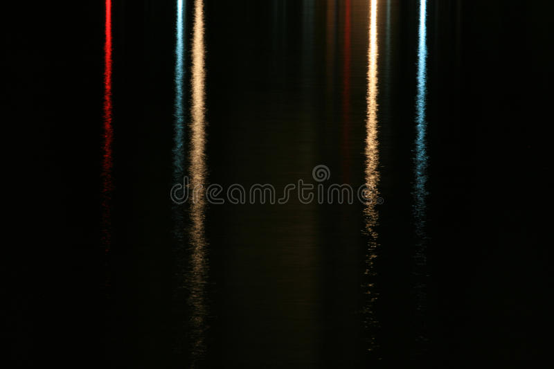 Lights reflected on water stock photo