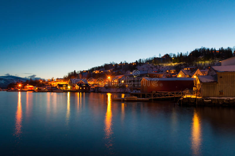 Lights reflecting in fjord near Sjursnes village, Norway stock photo