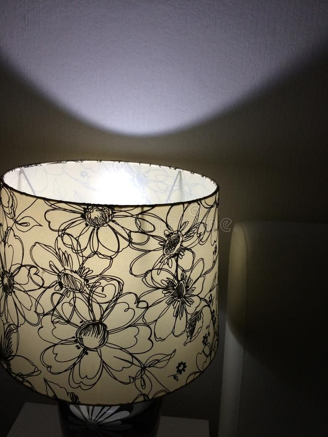 Lights shine bright. The lamps provide illumination at night. stock photo
