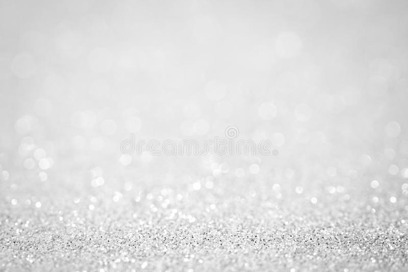 Lights on white silver background abstract beautiful blink light. With bokeh bright winter and christmas decoration design blur backdrop luxury royalty free stock images