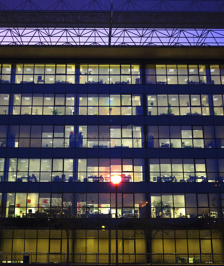 Download Lights On The Windows Of An Office Building Stock Photo - Image: 83712570