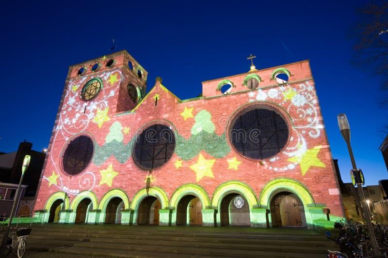 Lightshow sur l'église photo stock