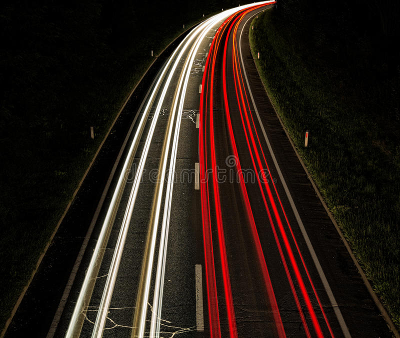 Lighttrails on the road royalty free stock photos