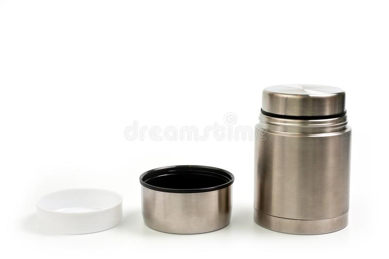 Lightweight, metallic thermos for eating with a plastic plate on a white background royalty free stock images