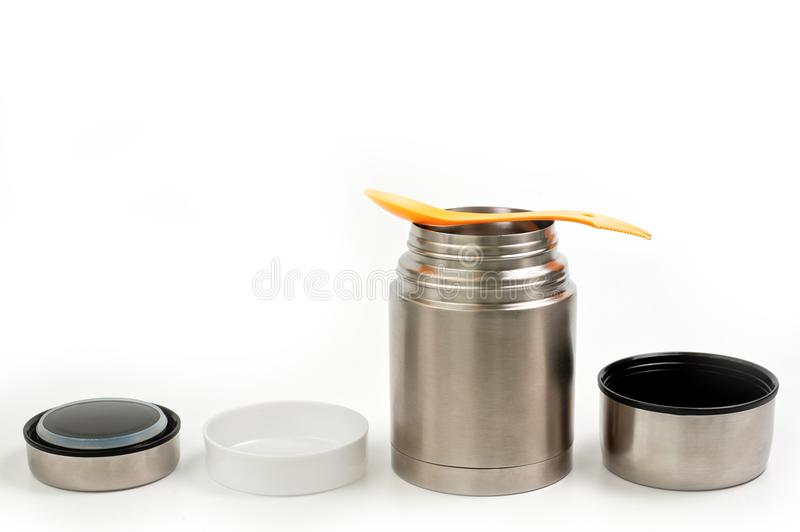 Lightweight, metallic thermos for eating with a plastic plate on a white background royalty free stock photography