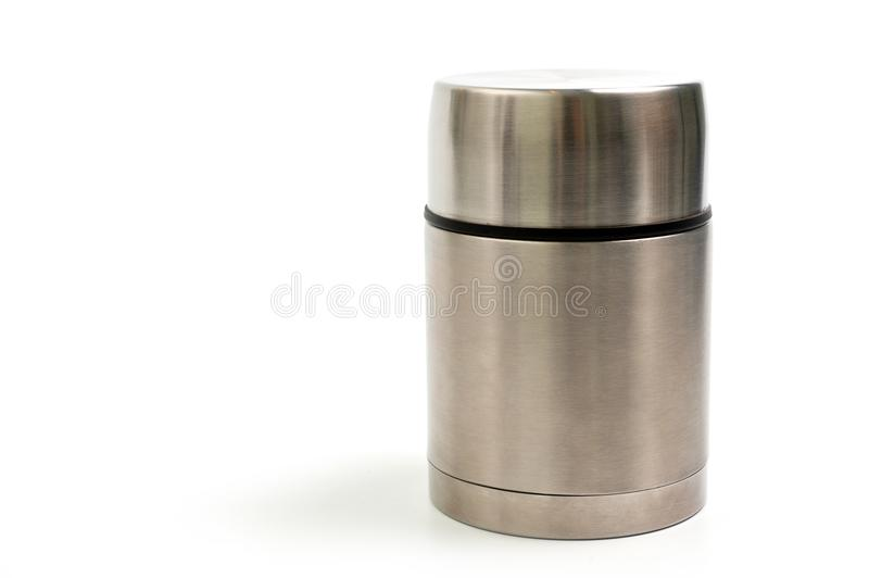 Lightweight, metallic thermos for eating with a plastic plate on a white background royalty free stock image