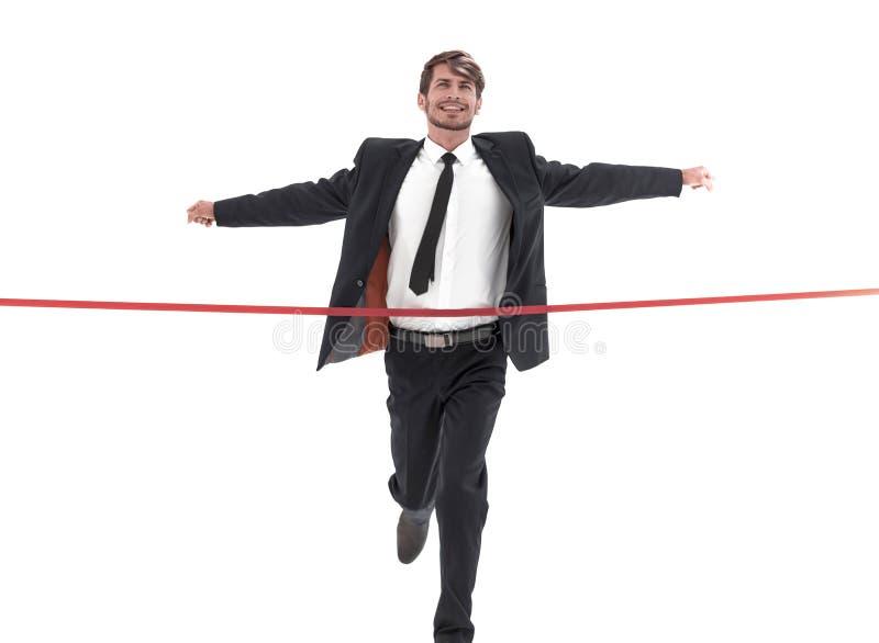 Ligne d'arrivée heureuse de croisement d'homme d'affaires sur le fond blanc images stock