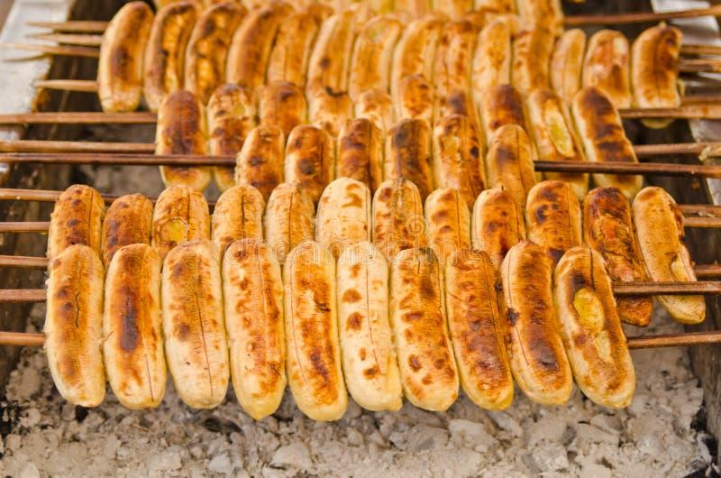 Ligne de banane grillée, dessert thaï photos stock