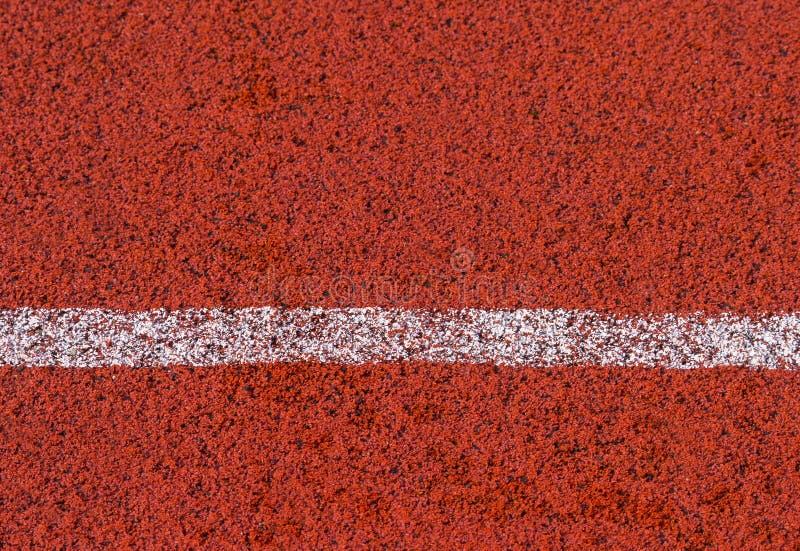 Ligne de couleur de voie courante et blanche rouge standard en caoutchouc photo stock