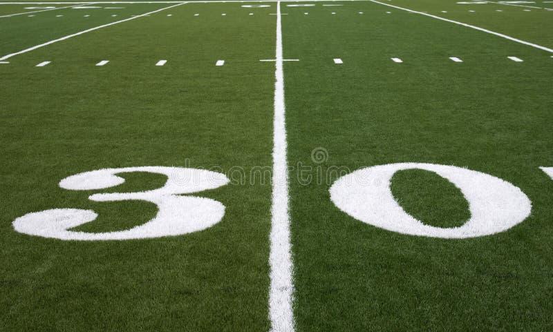 Ligne de yard du terrain de football 30 photo stock