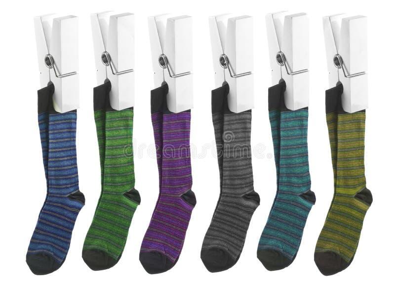 Ligne des chaussettes sur des chevilles images stock
