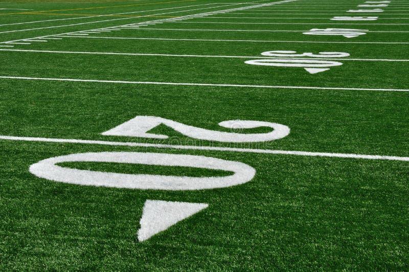 Ligne du yard 20 sur la zone de football américain photos stock