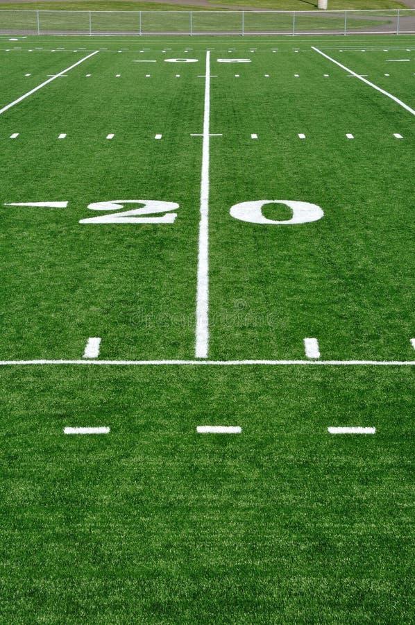 Ligne du yard vingt sur la zone de football américain images stock