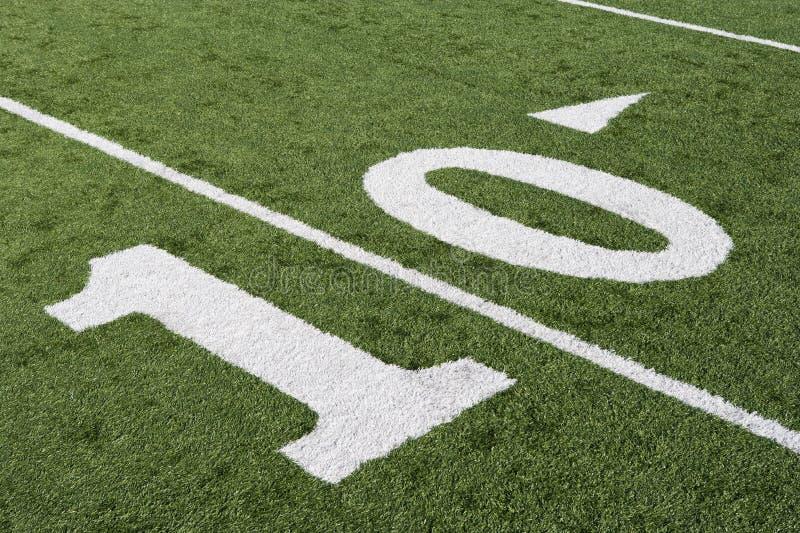 Ligne 10 sur le champ de football américain image libre de droits