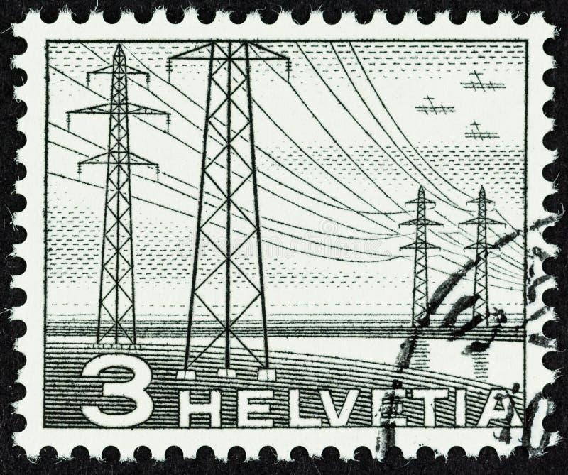Lignes électriques sur le timbre-poste suisse photographie stock libre de droits