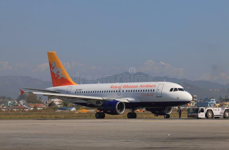 Lignes aériennes royales du Bhutan images libres de droits