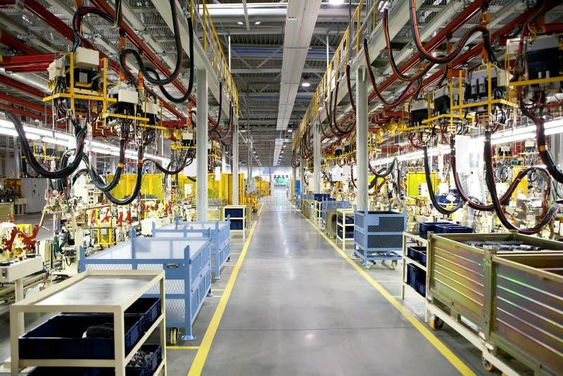 Lignes de production de robotique image stock