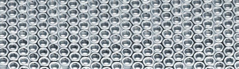 Lignes des noix d'hexa en métal images libres de droits