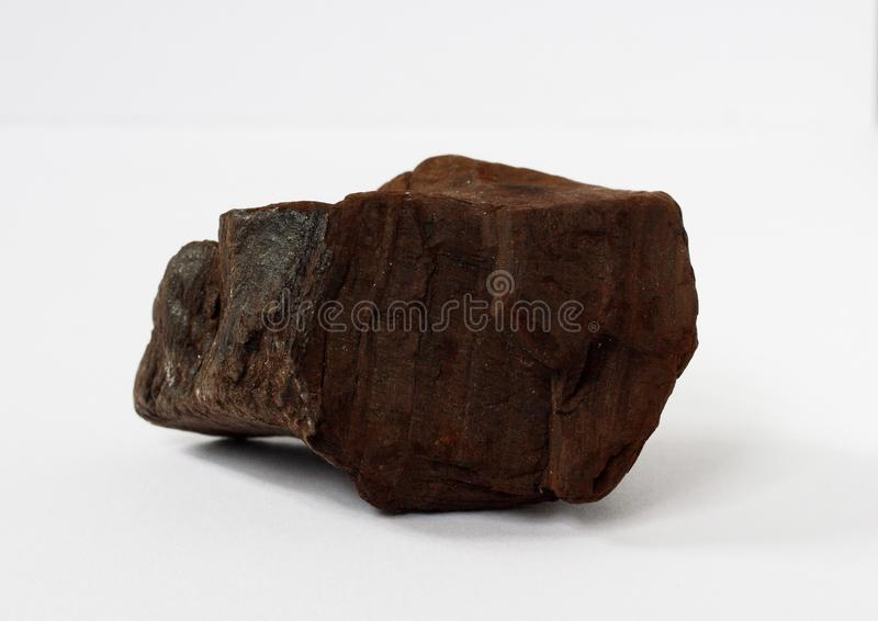 Lignite or brown coal mineral on white background royalty free stock images